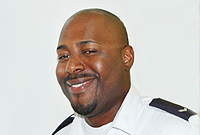 Front-line staff, such as Immigration Officer Carlington Dawson, will meet with the public.